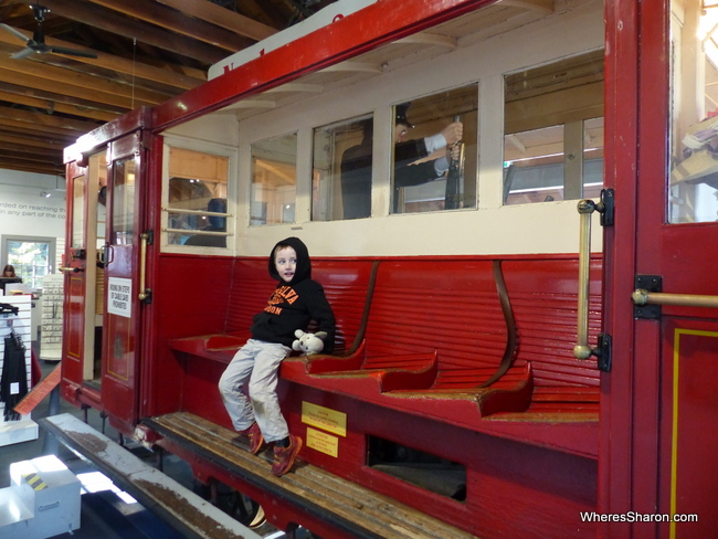 Z riding an old cable car at the Cable Car Museum, one of the many great free activities in Wellington.