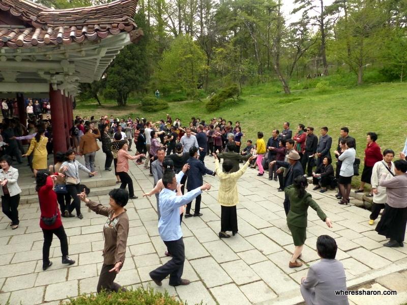 Dancing with locals at Moran Hill, Pyongyang