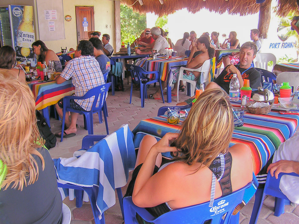 International crowd watching World Cup Soccer at Open-Air Beach Restaurant Paa Mul in Mexico's Riviera Maya.
