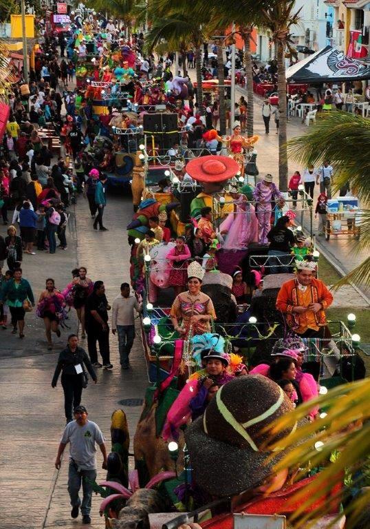 Joyous Carnaval Parade Along Avenida Rafael Melgar in Cozumel, Mexico.