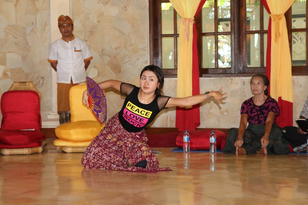 Balinese dancing protege teaching westerners how to express the traditional stories with eyes and gestures