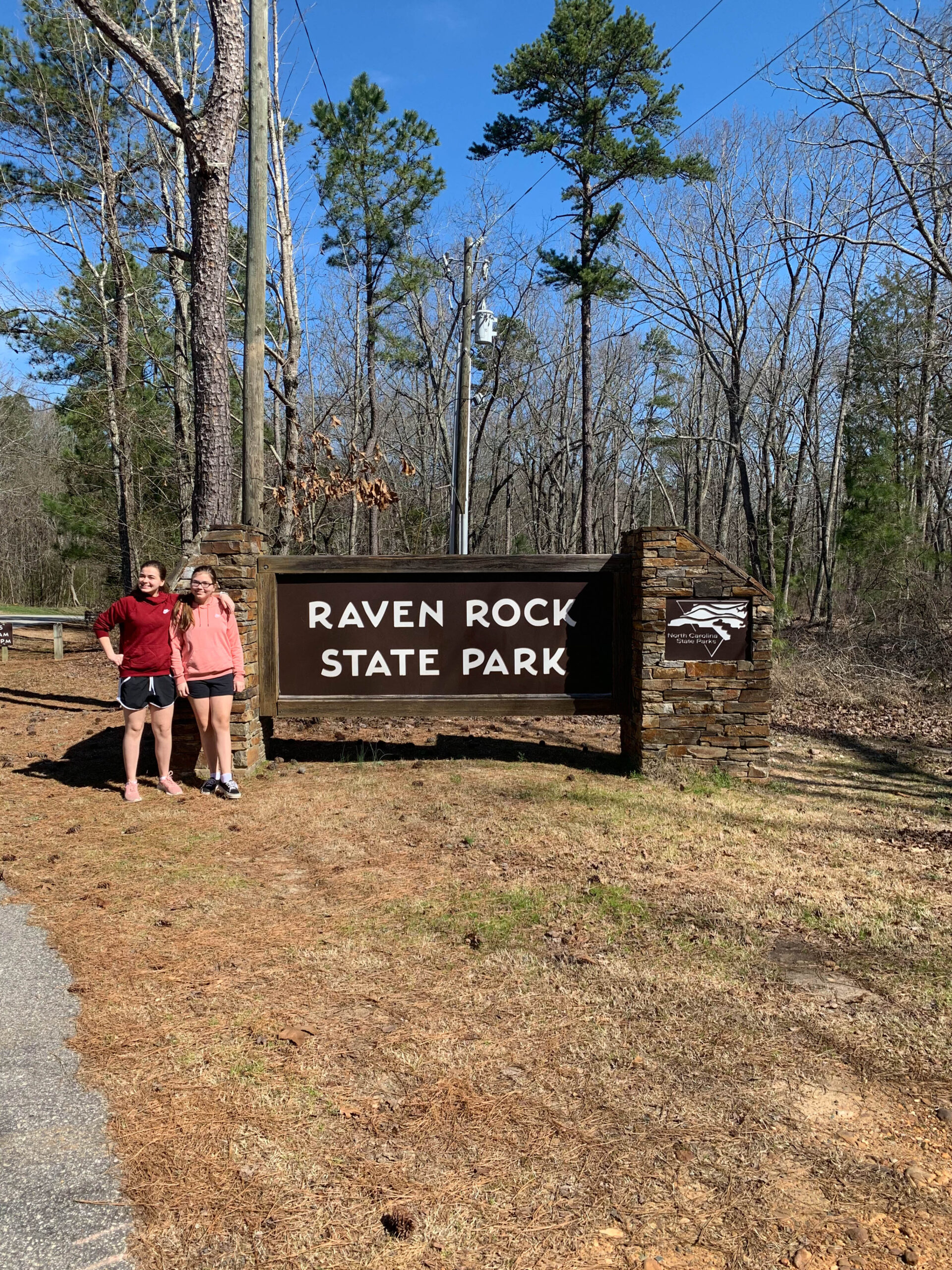 two girls standing at the entrance to Raven Rock State Park