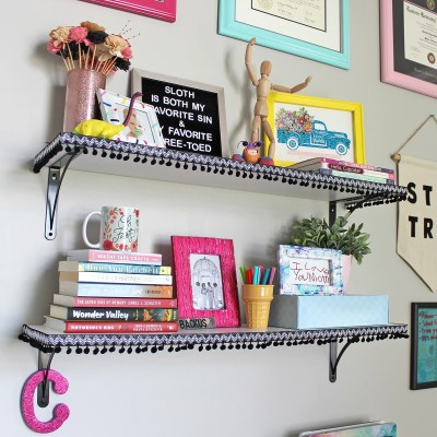 Add Pom Pom Trim to Shelves for an Inexpensive and Fun Update!