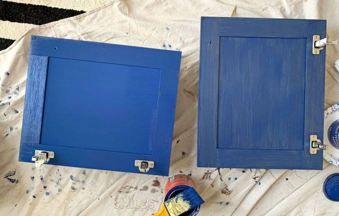 Painting bathroom cabinets blue. Two coats versus one.