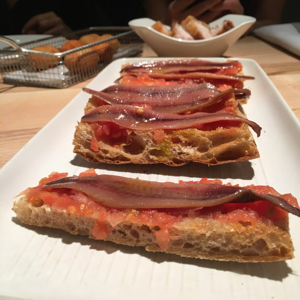 Restaurante Orgaz. Starters, anchovies with tomato and bread.