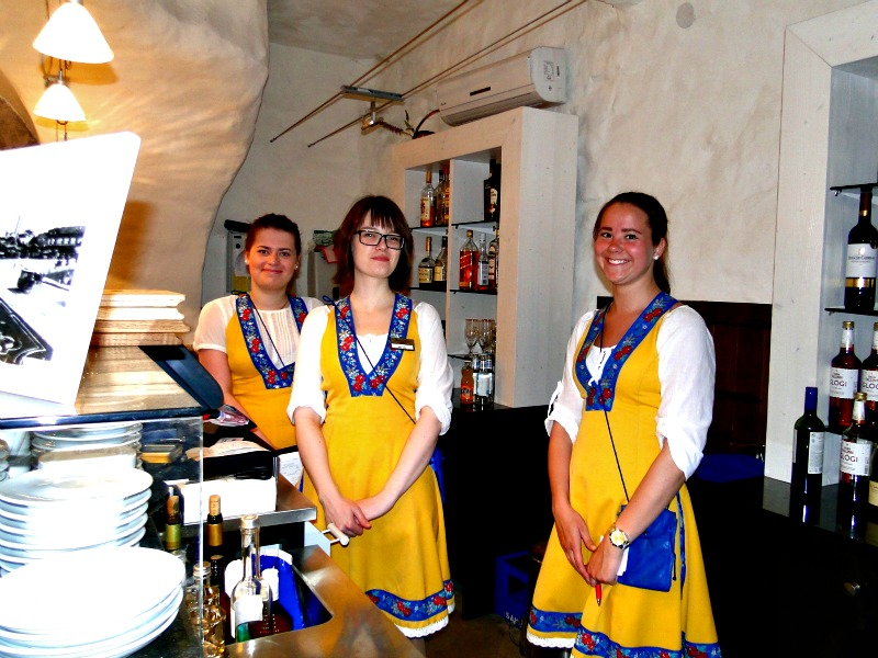 Many of the servers in Old Town restaurants wear traditional dress.