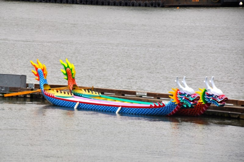 The dragon boats are so colorful on the riverbank in Portland.