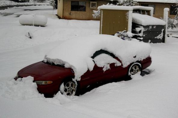 Snow on car in California