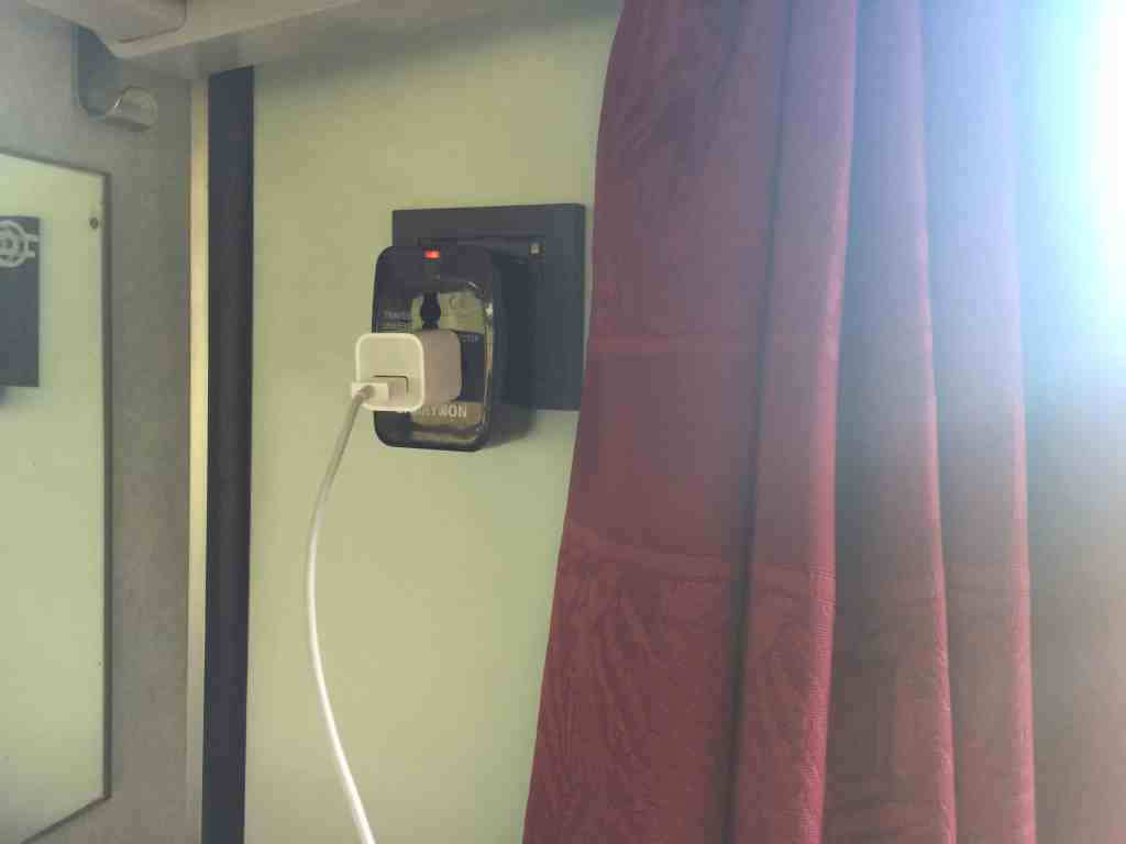 Train from Vienna to Budapest - Closeup of outlets on train with adapter