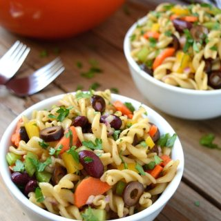 """A healthier, vegan Italian Pasta Salad prepared with a sweet and tangy, homemade balsamic vinaigrette. A """"must have"""" for any summertime picnic or gathering. It's quick, easy to make and ready in under 30 minutes! Plus, swapping out the noodles instantly makes this gluten-free!"""