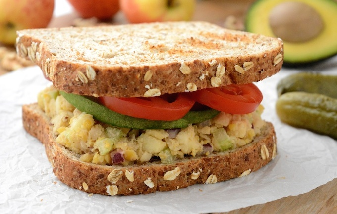 A vegan Apple-Walnut Chickpea Salad Sandwich that tastes like no other! It's made with an oil-free tahini dressing, gluten-free and ready in under 15 minutes. Prep the salad ahead of time for a quick, grab-and-go, healthy lunch.