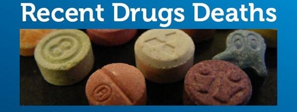set of pills with warning of recent drug deaths