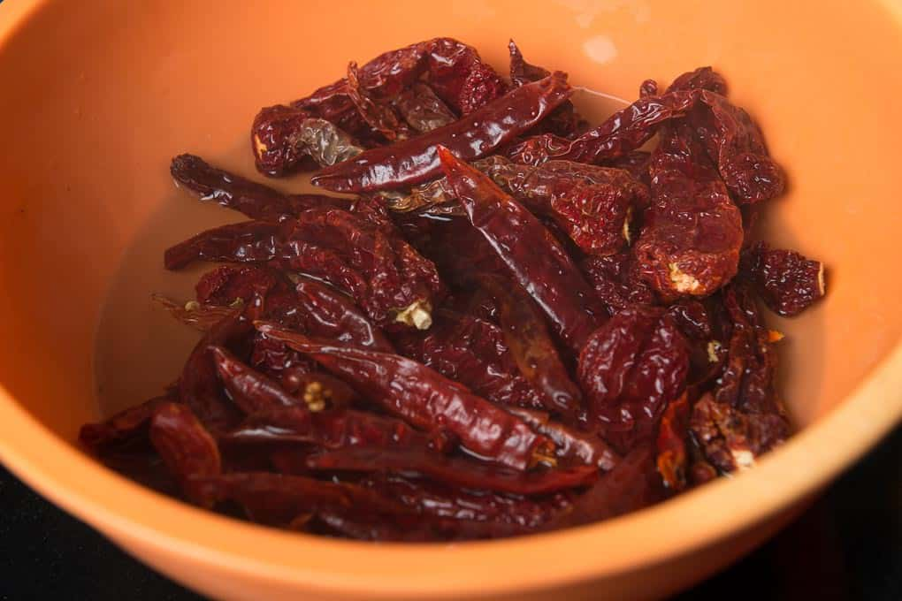 Boiling water added in the bowl with chillies.
