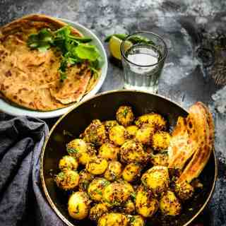 Zeera Aloo is a flavorful, delicious and irresistable dish of baby potatoes and cumin seeds.