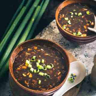 Vegetable Hot and Sour Soup is a spicy, tangy accompaniment for all your meals. Suit it to your taste and eat it when its piping hot!