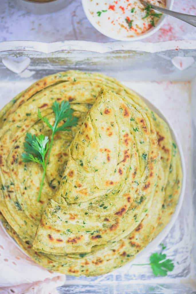 Methi Laccha Paratha is a super delicious, flavoured, multi-layered flat bread which has a distinct aroma of fenugreek and freshly baked whole wheat flour. Methi Laccha Paratha Recipe, Lachha Paratha Recipe, Lachedar Paratha Recipe, lachha paratha video, lachha meaning,