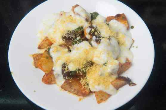 Potato cubes topped with chutneys and curd