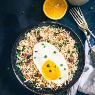 Loaded with bacon and eggs, Breakfast Bacon Fried Rice Recipe turns out to be an interesting combination which you can savour any time of the day!