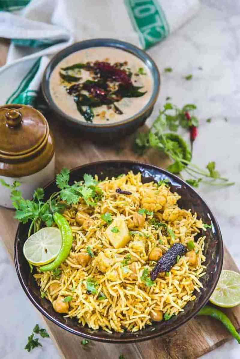 A completely different take on how to serve Chana and a platter of rice together, Achari Chana Pulao Recipe is an interesting recipe that tastes delicious.