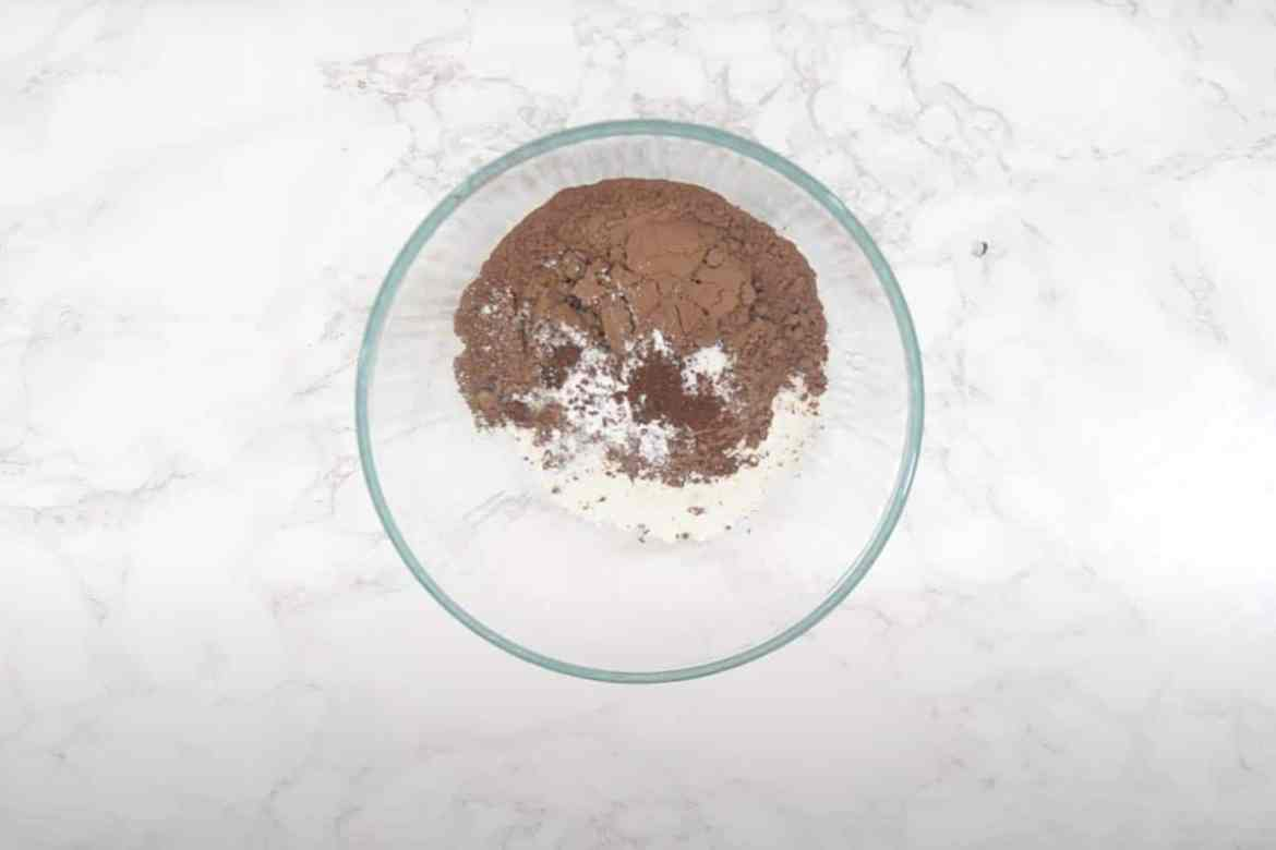 All-purpose flour, cocoa powder, baking powder, salt, and instant coffee powder mixed in a bowl.