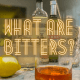 A header image featuring an old fashioned and bitters