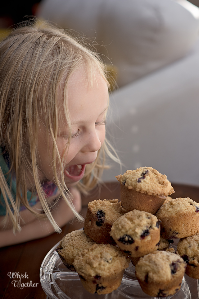 Girl eating Blueberry Muffins