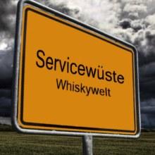 Ortseingangsschild Servicewüste Whiskywelt mit schwarzen Wolken