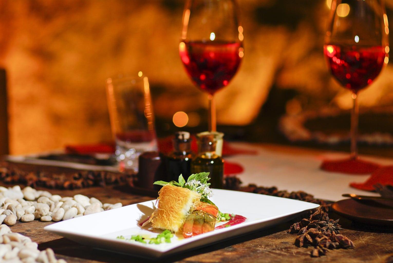 salmon steak dinner with red wine
