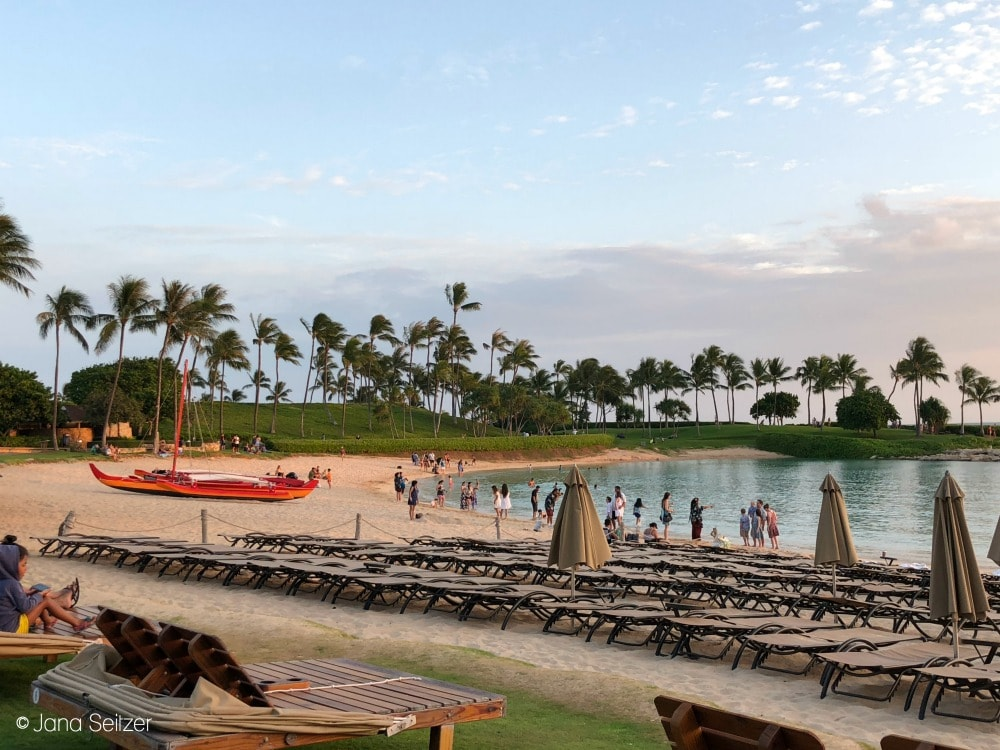 sunset at the ocean front at Disney Aulani with beach chairs
