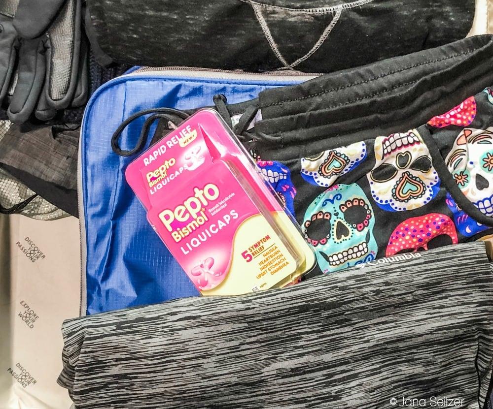 pepto bismol liquicaps in a suitcase