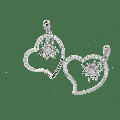 Le cœur de notre pendentif Edelweiss en argent 925 mesure 2.5 cm x 2.5 cm alors que la petite edelweiss by White Alpina. mesure 1cm x 1cm