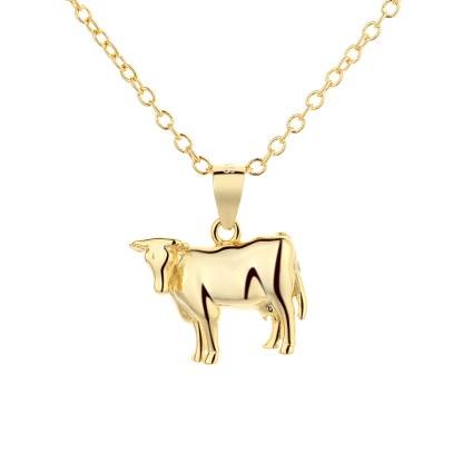 Pendentif en argent 925 doré en forme de vache de la race Holstein by White Alpina.