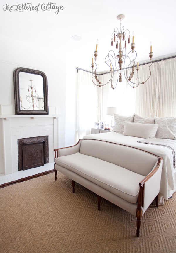Master-Bedroom-White-and-Neutrals-Fireplace-Chandelier-Loveseat