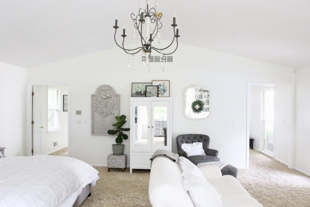 White Cottage Master Bedroom- gray- white- green- shabby chic bedroom- farmhouse decor- layered mirrors- painted gray furniture- DecoArt- Repose Gray- white bedding- white painted furniture- Armoire- fireplace in the bedroom- home design- large bedroom space- sitting area in the bedroom- bookshelves in a bedroom- white couch