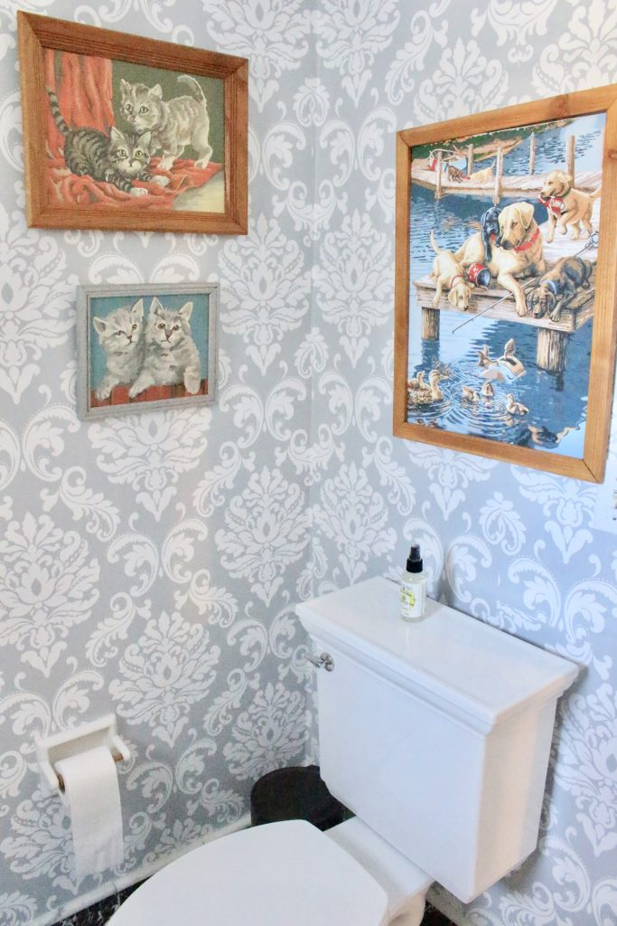 removable wallpaper- peel and stick wallpaper- updating with wallpaper- powder room refresh- small bathroom decorating- bathroom decor- paint by number vintage paintings- bathroom decor ideas- damask wallpaper