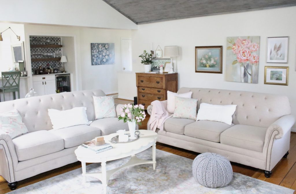 An updated family room space with seasonal spring decor, spring- family room decor- gray washed ceiling- pink decor- gray decor- using pastels in decorating- large family room space
