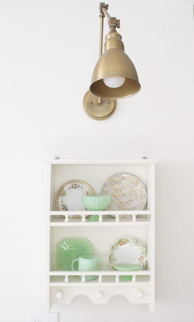 A cute little wood plate shelf- plate rack- wood shelf- jadeite- vintage china- thrifted plates- peninsula- kitchen decor- kitchen decorating- cottage kitchen decor- brass fixtures