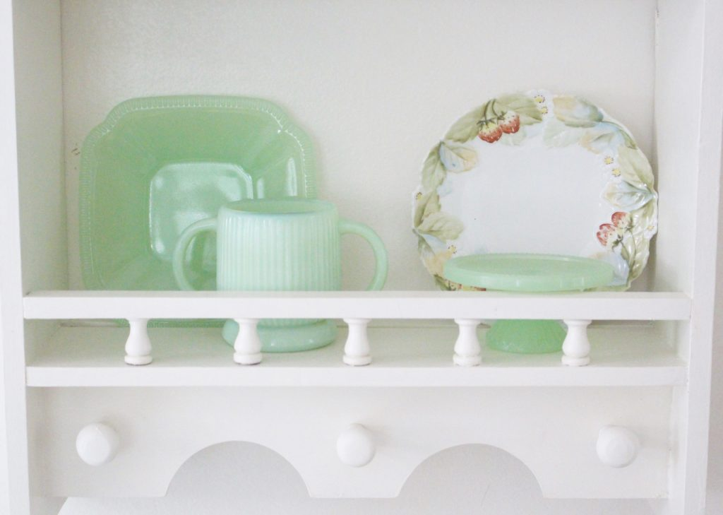 A cute little wood plate shelf- plate rack- wood shelf- jadeite- vintage china- thrifted plates- peninsula- kitchen decor- kitchen decorating- cottage kitchen decor- wood shelf