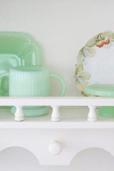 A cute little wood plate shelf- plate rack- wood shelf- jadeite- vintage china- thrifted plates- peninsula- kitchen decor- kitchen decorating- cottage kitchen decor- wood shelf