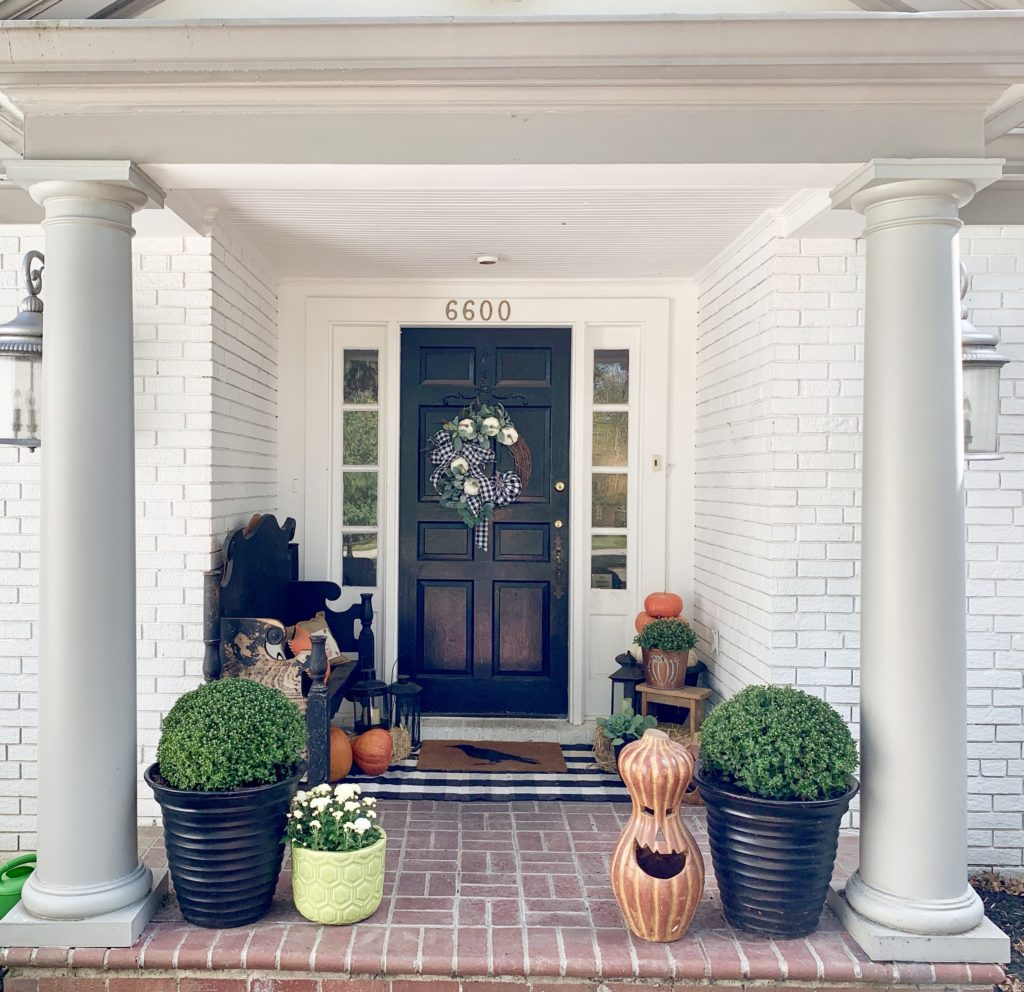 Fall Porch with Touches of Halloween, front porch decor, fall porch decor, pumpkins, decorating for Halloween, lanterns, porch decorating, fall, layered rugs, mums, porch bench, fall wreath