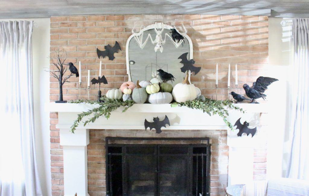 Fall Mantel Updated for Halloween- halloween mantel- crows- bat skeleton- pumpkins- pumpkin patch mantel- cottage style- halloween decor- fireplace decor- decorations for Halloween