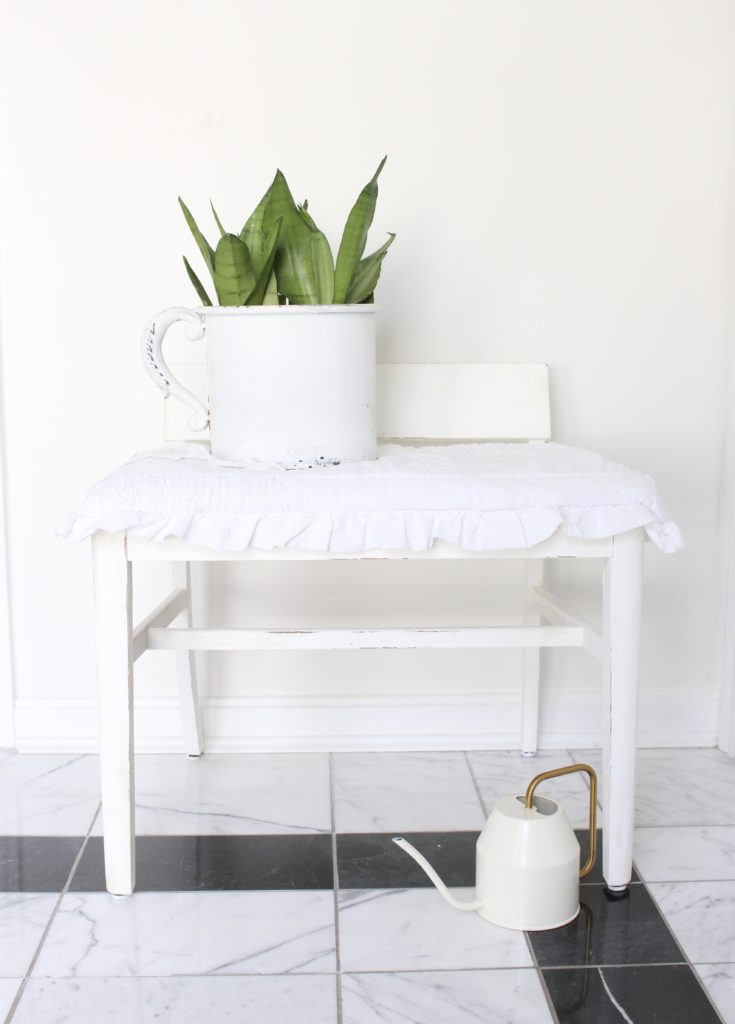Painting and Recovering a Thrift Store stool- painted furniture- shabby chic decor- chalk paint- how to use chalk paint to update thrift store finds- thrift store makeover- vintage stool- white painted furniture- easy reupholstering- pillowcase as a seat cover