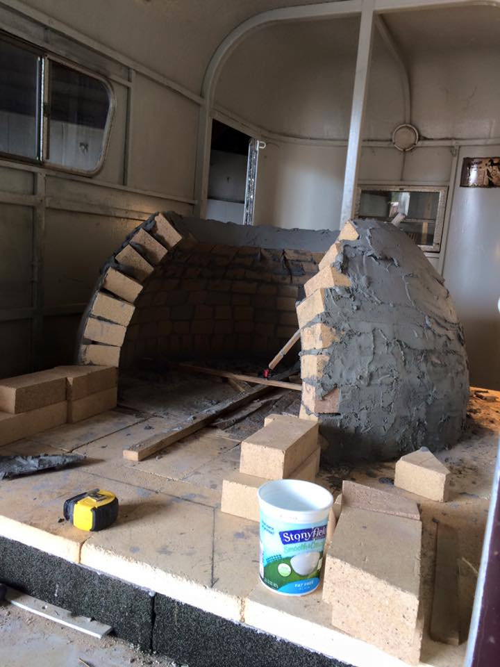 Mobile pizza oven being built