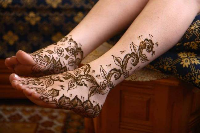 black henna ink tattoo designs on foot
