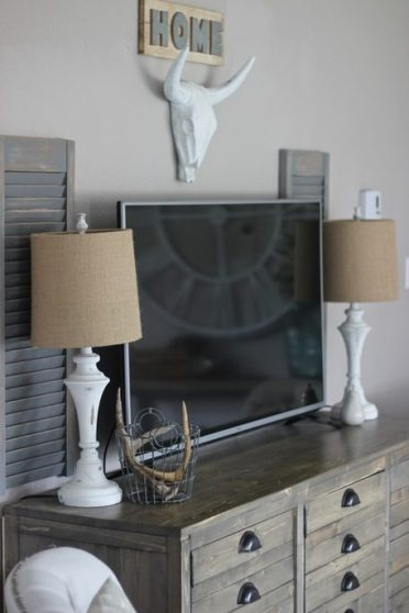 Painted White lamps on printers cabinet with painted Antlers and Shutters
