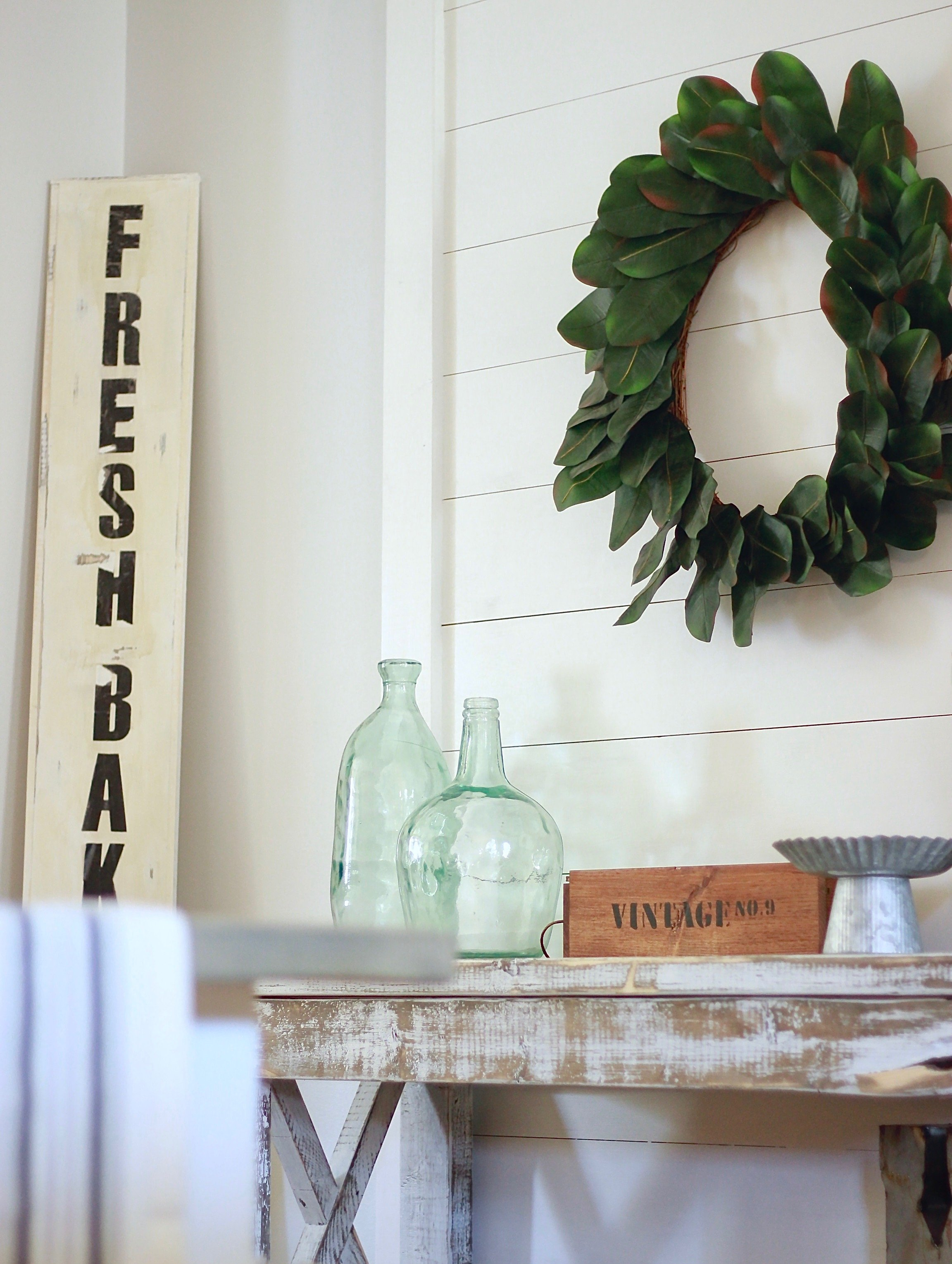 DIY Shiplap Decor Wall. Under 20 dollars and 1 hour, perfect for renters who can't put hundreds of holes in their walls www.whitepicketfarmhouse.com