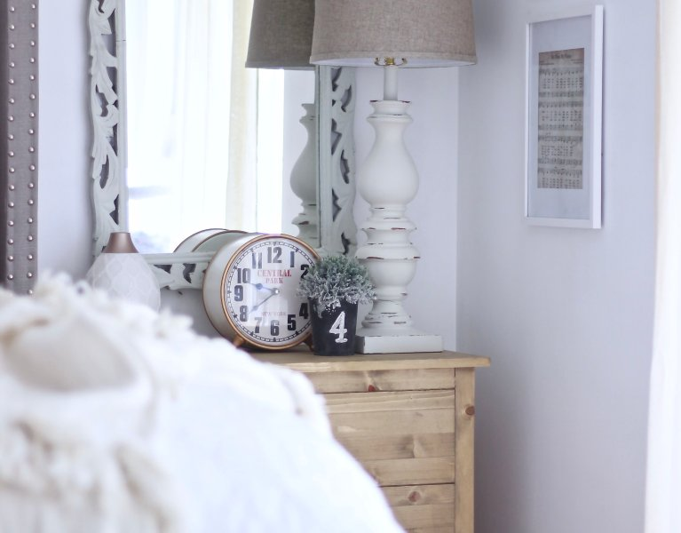 Farmhouse Master Bedroom Part Two . Check out how I styled our bedroom on a dime with Easy Printables, AHS Lighting and an Old Window. www.whitepicketfarmhouse.com #farmhousedecor #cheapdecor