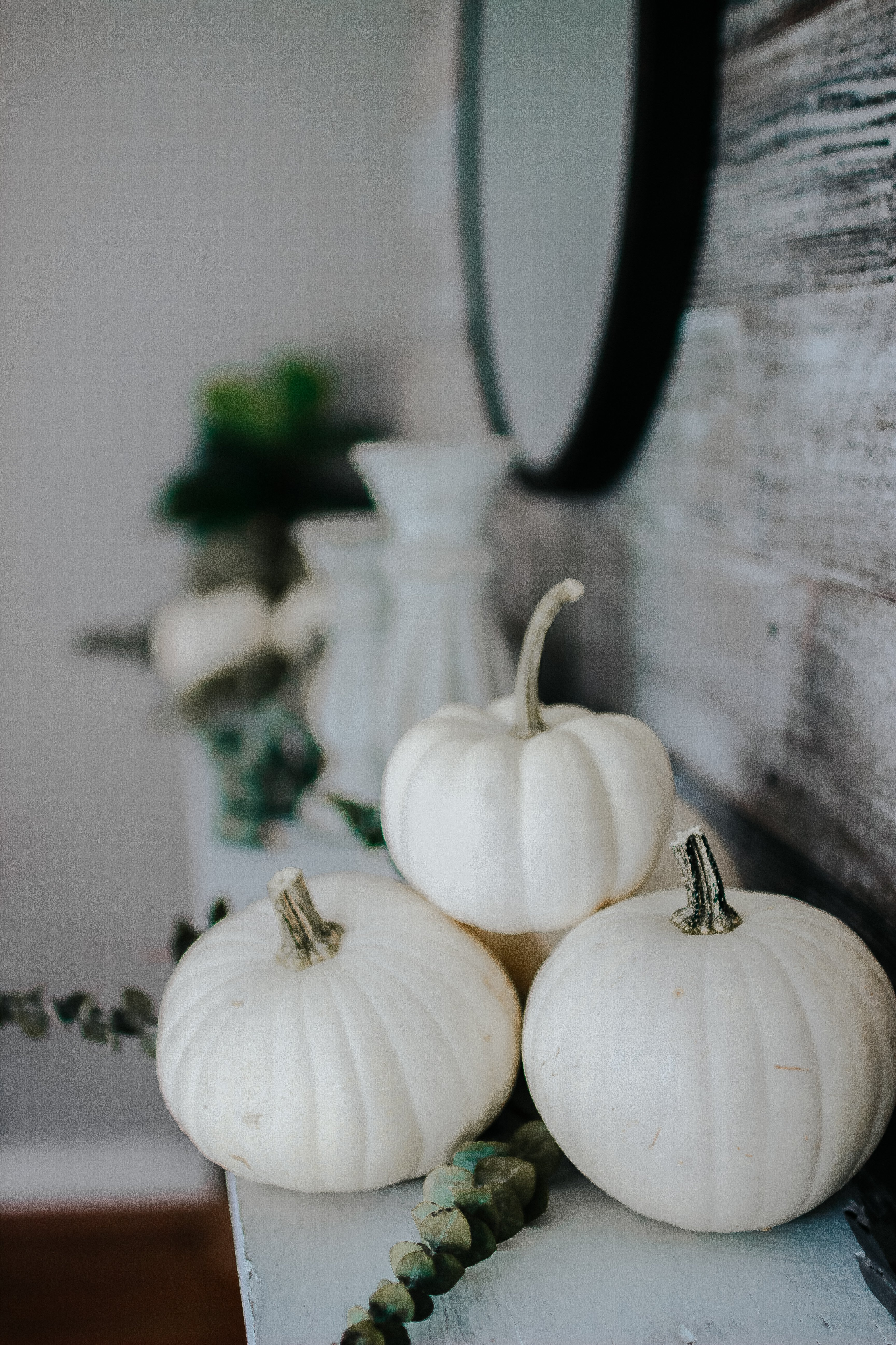 Neutral Fall Mantel. Modern Farmhouse Fall Mantel Super Easy Decorating For Fall That Doesn't Have to Cost A lot. Dried Eucalyuptus and Real Pumpkins and A Bit Of White Paint #falldecor #cheapfalldecorations #fallmantel