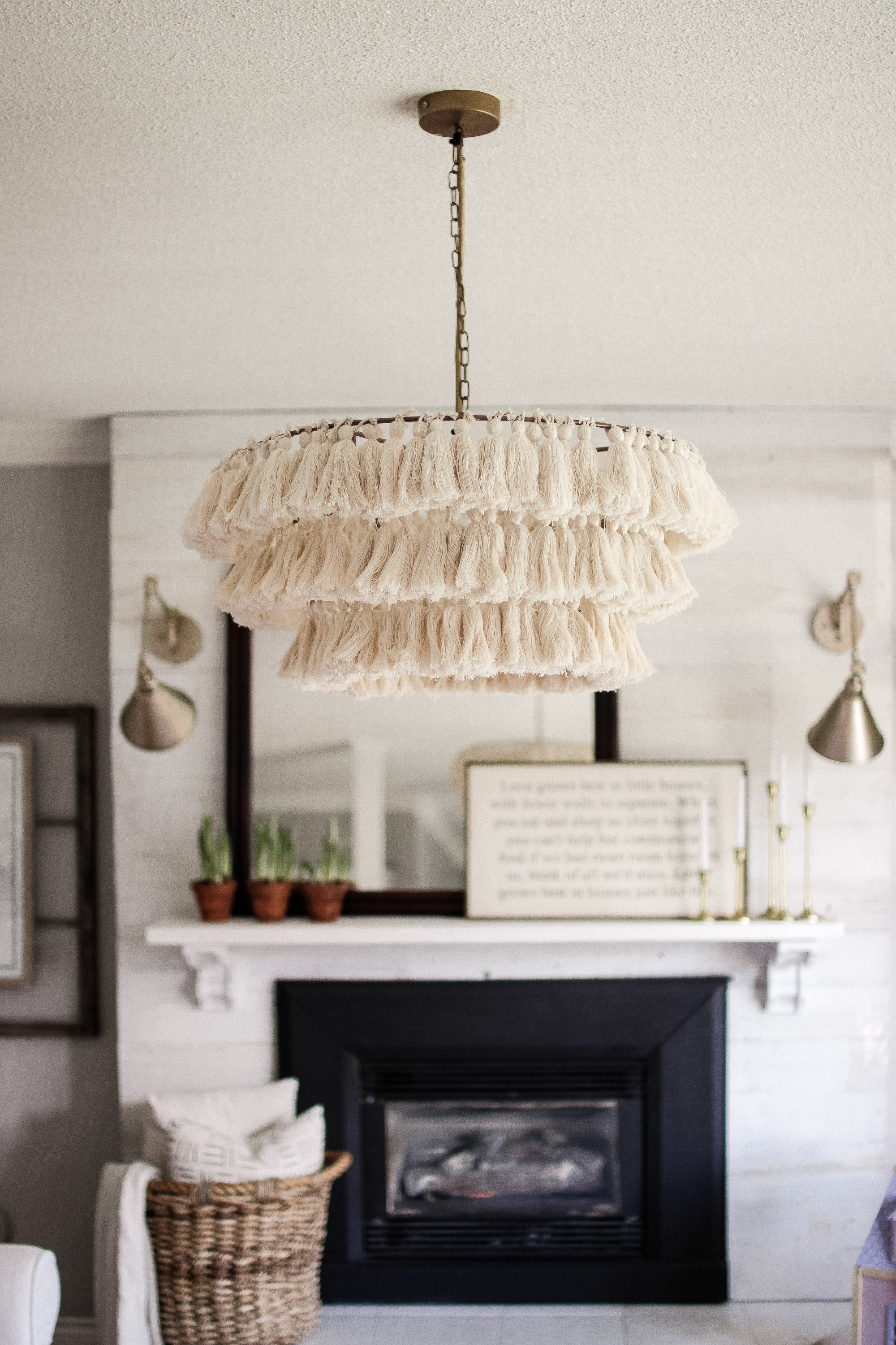 How To Decorate A Simple Spring Living Room. Gold Wall Sconces, Potted Tulips, Seafood accents and Tassel Chandelier