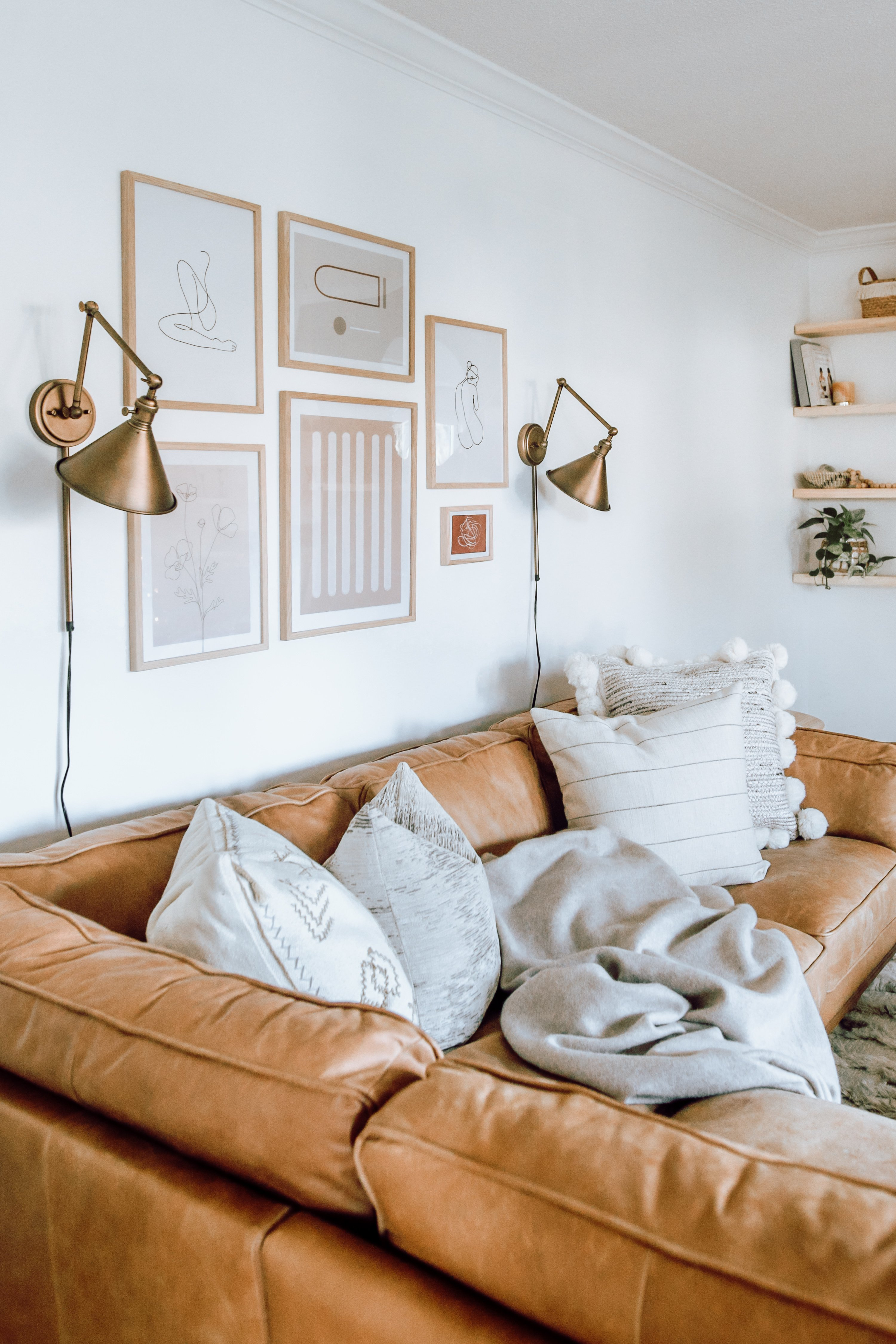 Our Sconce Feature Wall and similar sconces for less. Wall lamps that don't need to be hardwired. Also how to style them with a photo wall.